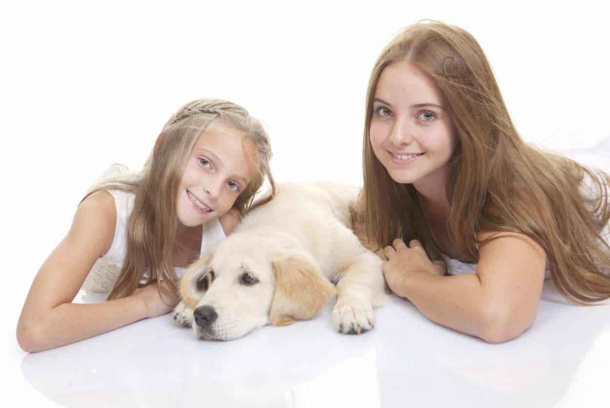 happy children with puppy dog
