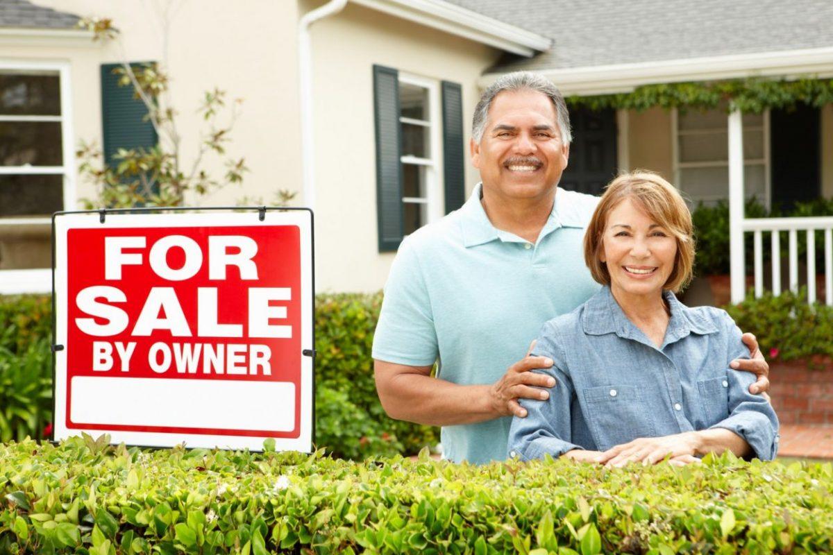 Senior Hispanic couple selling house