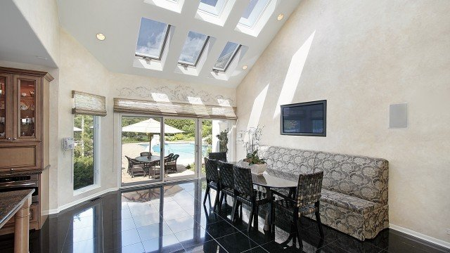 Sitting area near kitchen with skylights and pool view