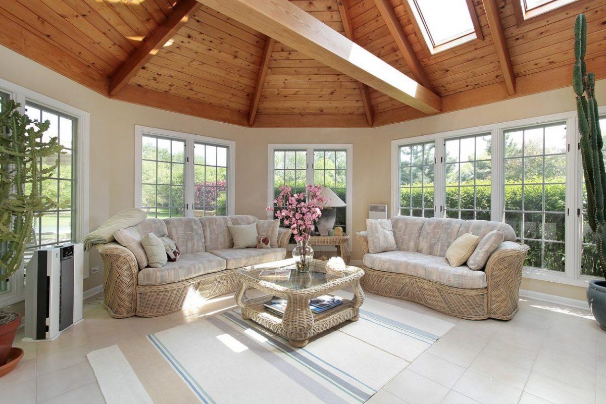 Sunroom with wood beams in luxury suburban home