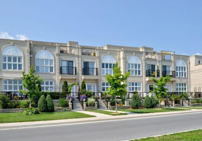 Modern Condominiums in urban setting under blue sky
