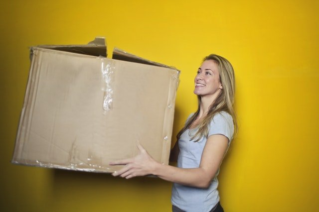 Lady moving a large box
