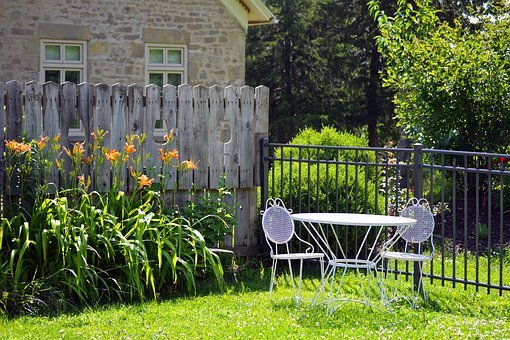 A fence immediately adds to your backyard privacy